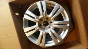 "Cadillac SRX  XT5 factory 18"" wheels with new snow tires."
