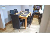 Oak dinning table and set of six chairs