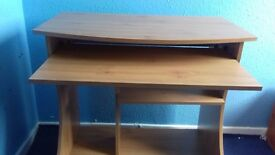 Pine desk with pull out keyboard shelf and printer shelf and adjustable chair. Will sell separately