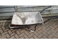Wheel barrow builders gardeners style been used for building extension good tyre
