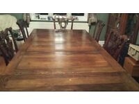 Antique solid oak table and 8 chairs