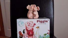 Piggin together collectors figurine.