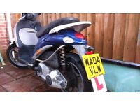 XXX SOLD SUBJECT TO COMPLETION XXX PIAGGIO LIBERTY 125 LARGER WHEELED SCOOT