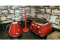 Red Delonghi kettle, red mug tree, toaster no longer available