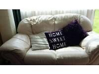 Cream leather sofa's