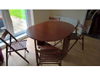 Oval Dining Table and 4 chairs. Drop leaves for space saving.
