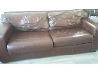 Brown Leather sofa, comfy, slouchy, lived in, has imperfections and scuffs