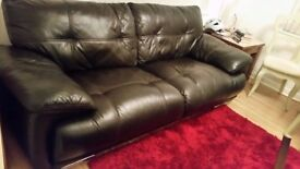 LARGE DARK BROWN/BLACK LEATHER SOFA. SEATS 3/4, VERY CLEAN AND COMFORTABLE. FROM PET FREE HOME.