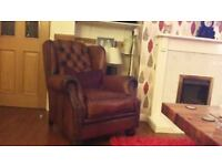 Tan leather wing back chair. Rarley used. immaculate condition