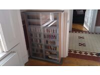 Large Compact Disc storage cabinet with glass sliding doors in excellent condition - holds 500 cds.