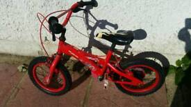Boys bike with stablizers