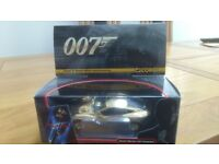 007 JAMES BOND ASTON MARTIN VANQUISH GOLD PLATED 1/36 scale.