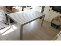 Grey slatted top table. 12 months old, great condition, 160cm x 100cm x 75cm high