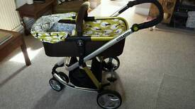 Cosatto Giggle carrycot in Treet, with chassis and free change bag!