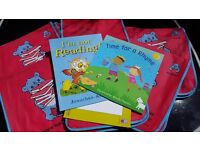 Job lot of New Children's First books in fabric storage satchel bags.