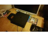 PS4 Slim 500GB with controllers and 2 games