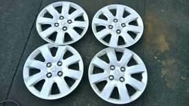 Genuine Peugeot wheel trims set of 4