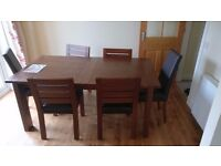 Large Marks and Spencer Sonoma extending dining table with 6 chairs - dark oak colour