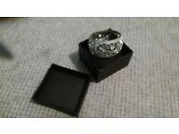 Silver coloured bangle with Diamante's. Stretch.