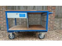 Heavy duty workbench table on wheels for garage tools.