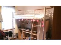 Bunk bed with under wardrobe desk and shelves