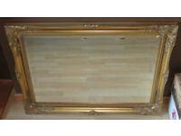 Classic ornate gold framed bevelled mirror
