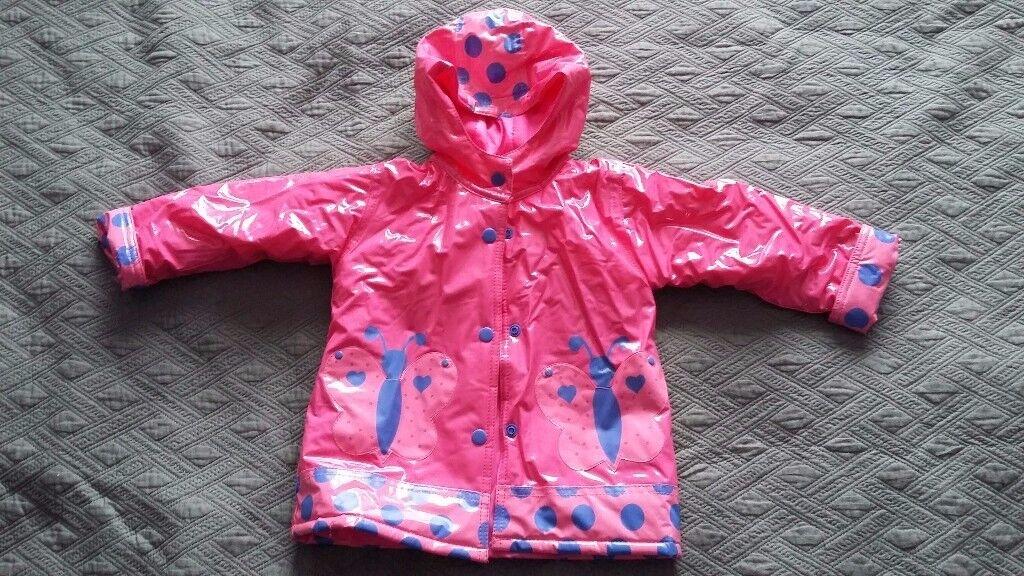 Girl rain coat, size 2-3 years.