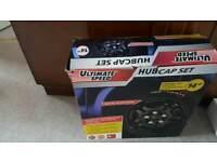 "Brand new 14"" hubcaps"