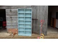 Massive Painted Bookcase Shelves Painted Blue.
