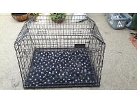 large dog cage with divider, designed and shaped to fit in the back of a car