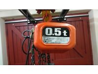 0.5tonne overhead hoist with double electric motorised opening doors and safety cage