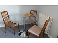 Circular glass and chrome table with 4x G plan chairs