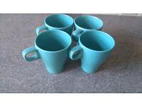 Four blue mugs used like new from Ikea