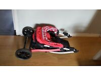 koochi buggy. Hardly used. Suitable from birth. Cosy toes and rain cover. Pink