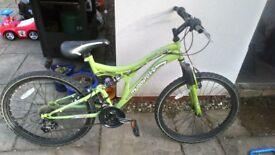 Muddy fox lime green bike