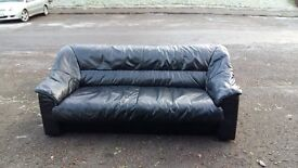 black leather sofa 70 inches wide. great condition
