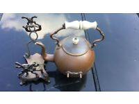 Vintage ornate copper kettle with ceramic handle with decorative stand