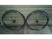 3x road bike wheels all same make one without the tube each 20 or all 55£ Can deliver or post