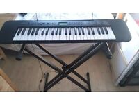Casio CTK - 240 Keyboard in very good condition and stand.