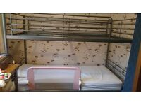 Grey metal bunk beds