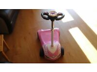 Pink childs electric scooter in excellent condition charger and lead.