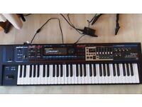 Roland Juno-Gi synth/8-track recorder