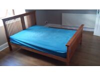 Double wooden bed frame head and foot with mattress. Needs some TLC