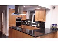 Beech wood kitchen with granite work tops