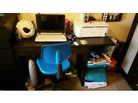 Black desk and blue chair