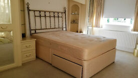 Double bed with divan base and storage.