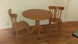 Pine table with two matching chairs