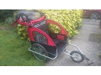 Bicycle trailer for 2 children. Converts to stroller.