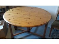 Wooden folding table, 115cm diameter. Good condition.