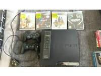 Sony PlayStation 3 320g and 4 games and 2 pads